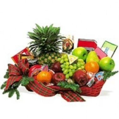 Basket of fruits, chocolates and cookies