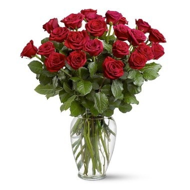 Two dozen roses in a glass vase