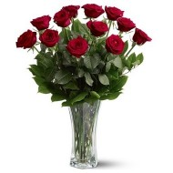 One dozen roses in a glass vase