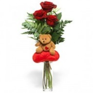 Little teddy bear with 3 roses
