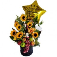 Sunflowers with fruits, wine and chocolates