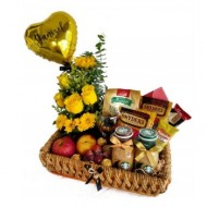 Basket of snacks and yellow flowers
