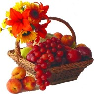 Frutal basket with lilies and sunflowers or gerberas.