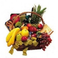 Basket of season fruits, cookies, cheeses chocolates and wine